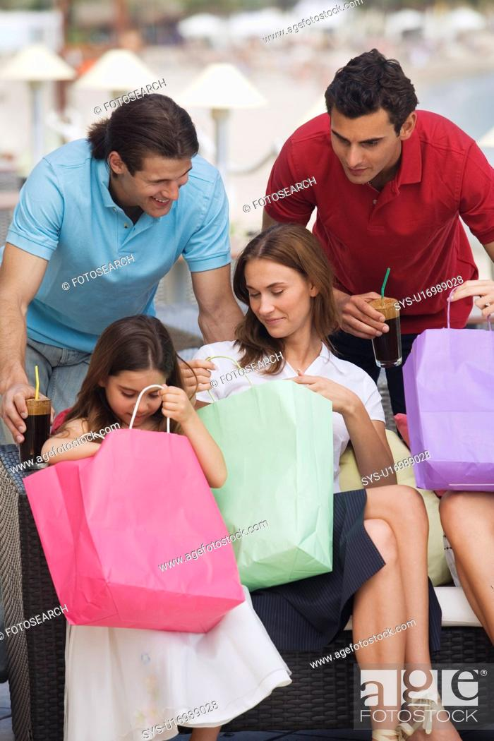 Stock Photo: Two couples and child with shopping bags.