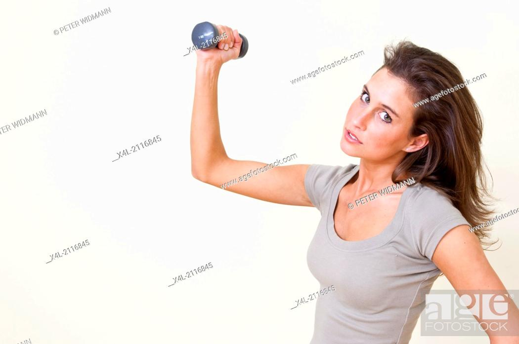 Stock Photo: young woman exercising with barbells (model-released).