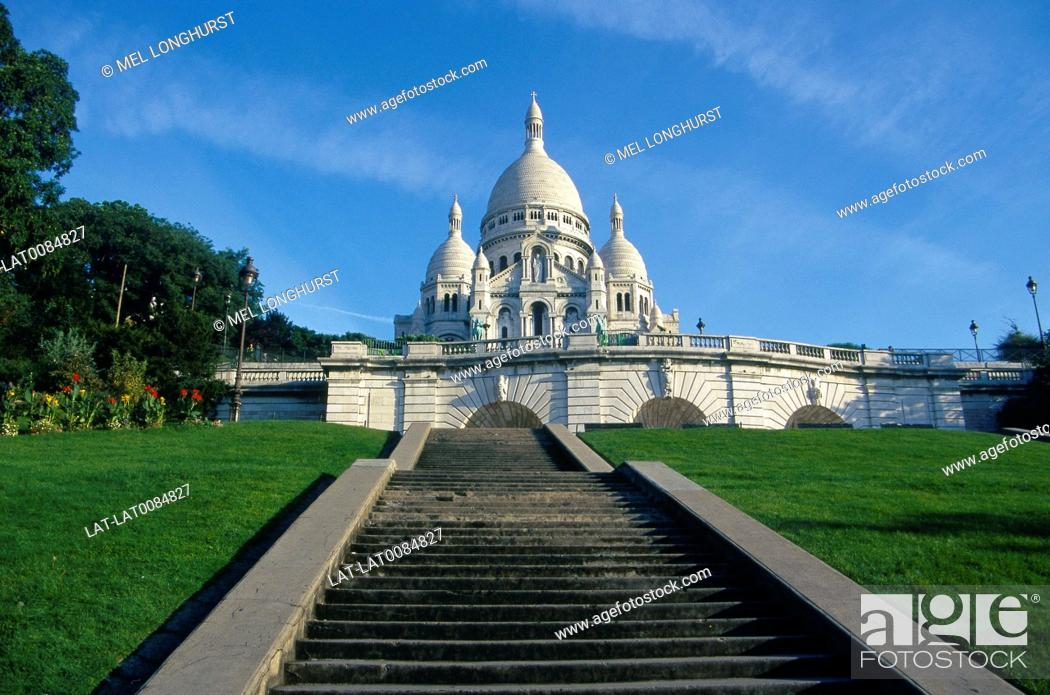 Stock Photo: Sacre Coeur. White domed church on top of hill. Against blue sky. Steps.
