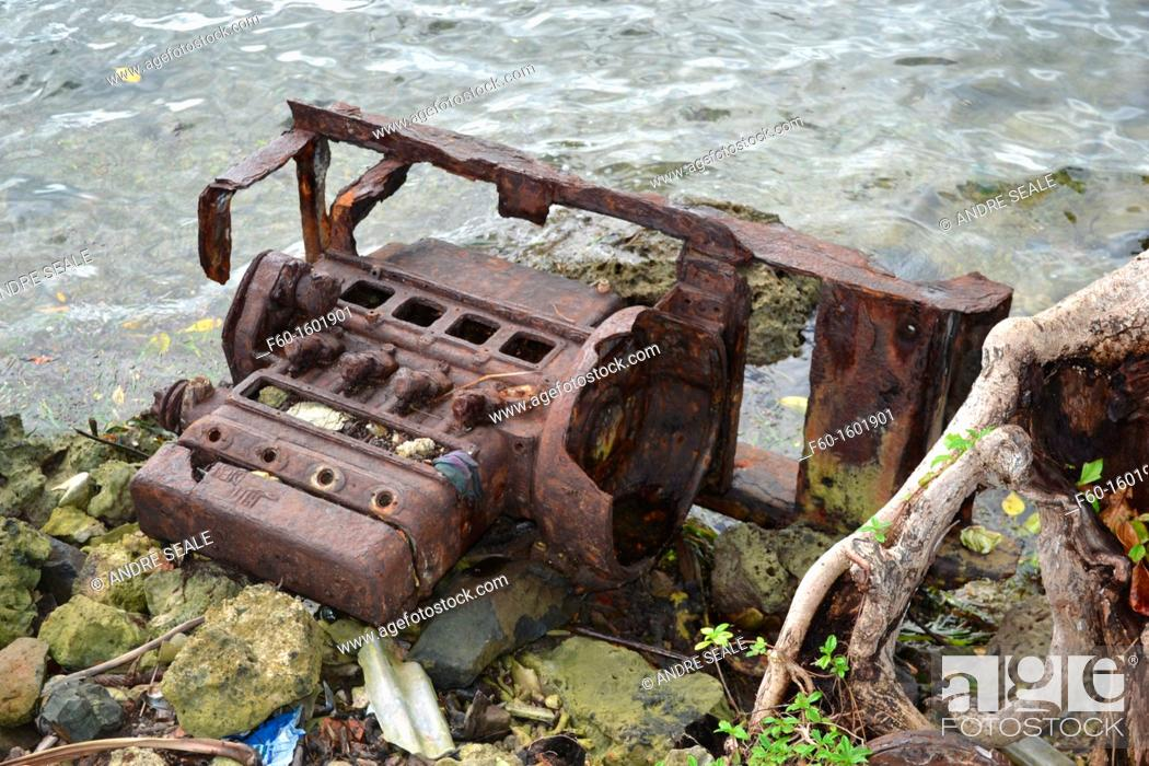 Stock Photo: Old rusty engine liters the coastline, Pohnpei, Federated States of Micronesia.
