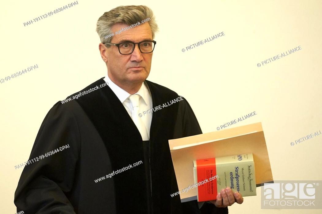 Stock Photo: 12 November 2019, Rhineland-Palatinate, Koblenz: The presiding judge, Ralf Bock, opens proceedings against a 46-year-old accused of attempted murder.