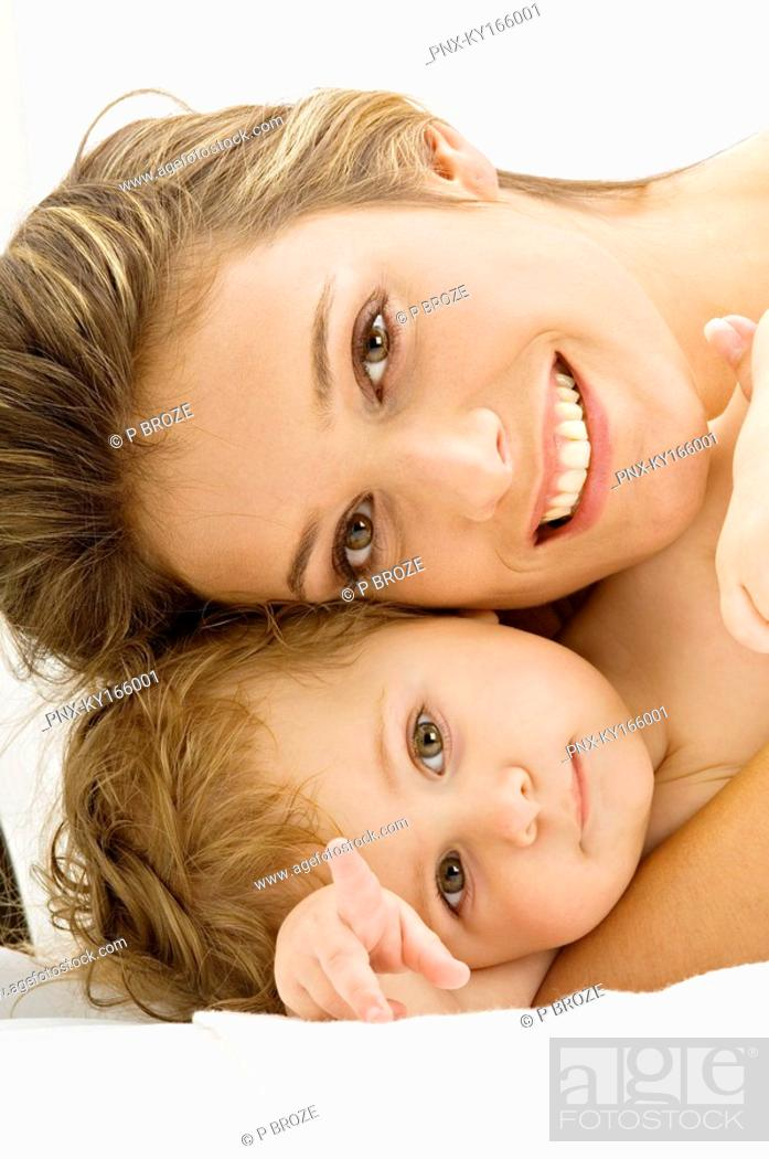 Stock Photo: Portrait of a young woman smiling with her son.