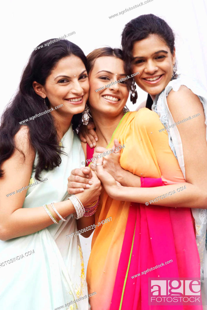 Stock Photo: Portrait of three young women holding their hands.