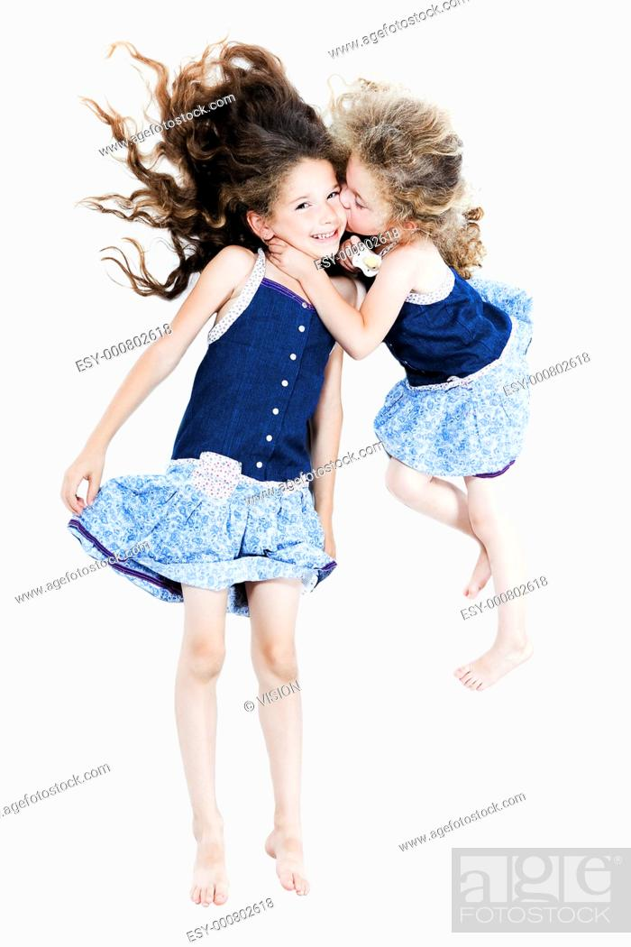 Stock Photo: two caucasian little girls kissing afection isolated studio on white background.