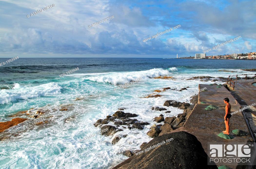 Stock Photo: male child standing contemplating the sea waves in Bajamar municipality Tenerife island.