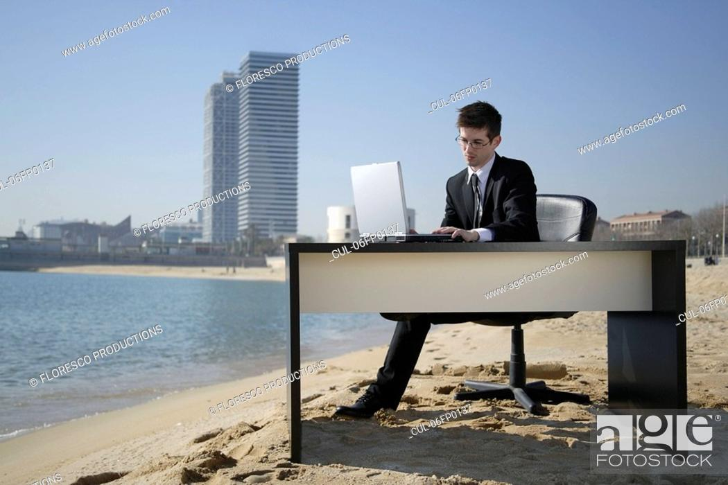 Stock Photo: Business woman in beachfront office.