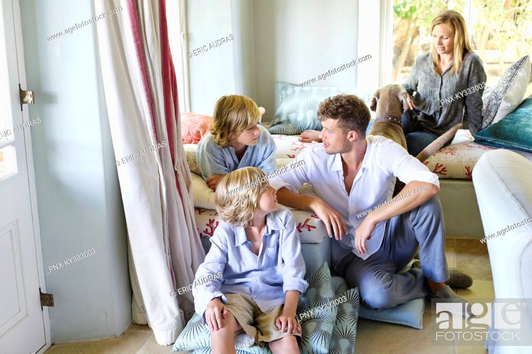 Stock Photo: Family sitting together at house.