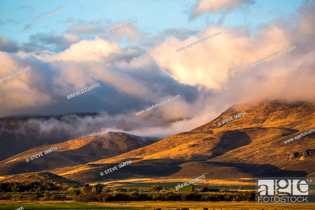 Stock Photo: Clouds over mountain range.