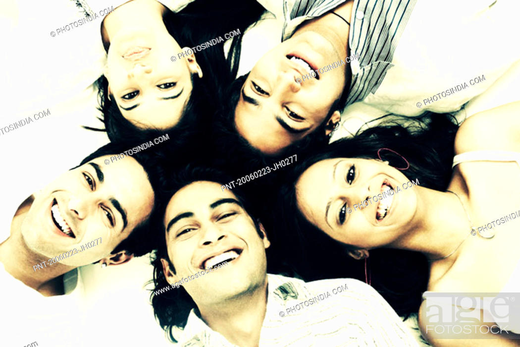 Stock Photo: Close-up of three young men and two young women lying down.