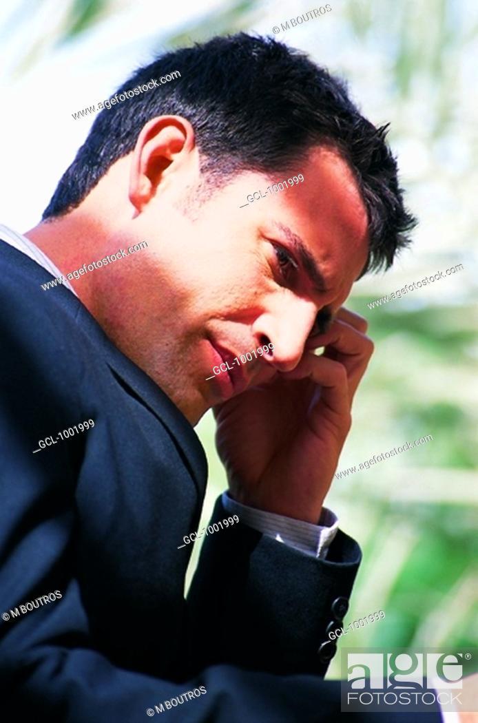 Stock Photo: Thoughtful businessman.