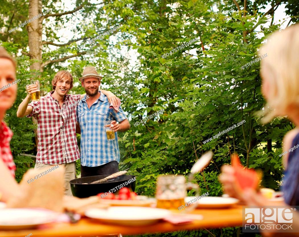 Stock Photo: Friends drinking beer outdoors.