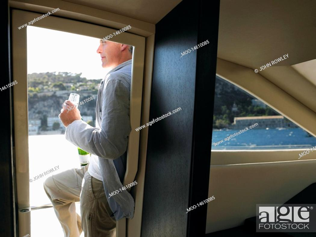 Stock Photo: Man Drinking Champaign on Yacht.