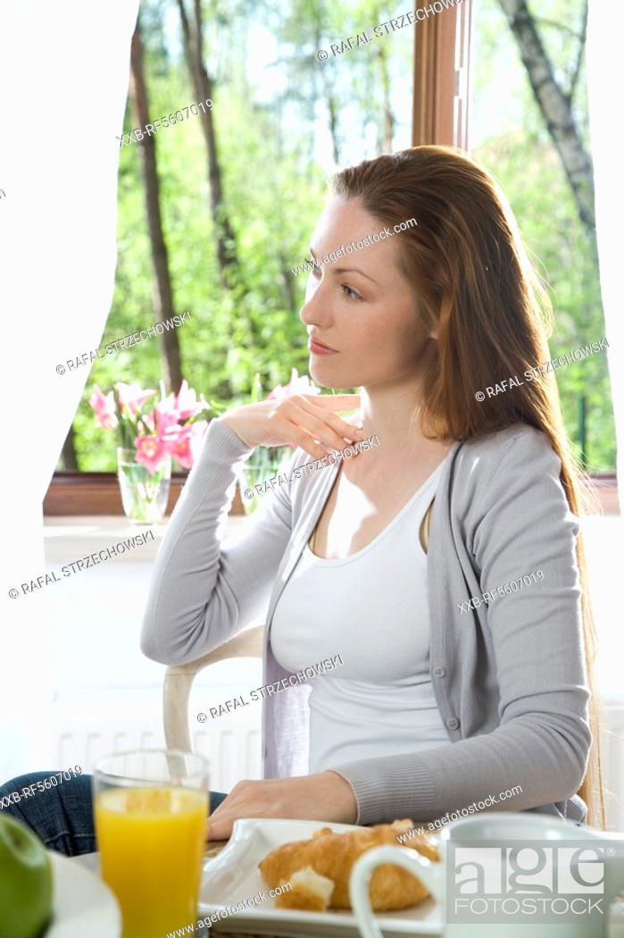 Stock Photo: woman eating breakfast.