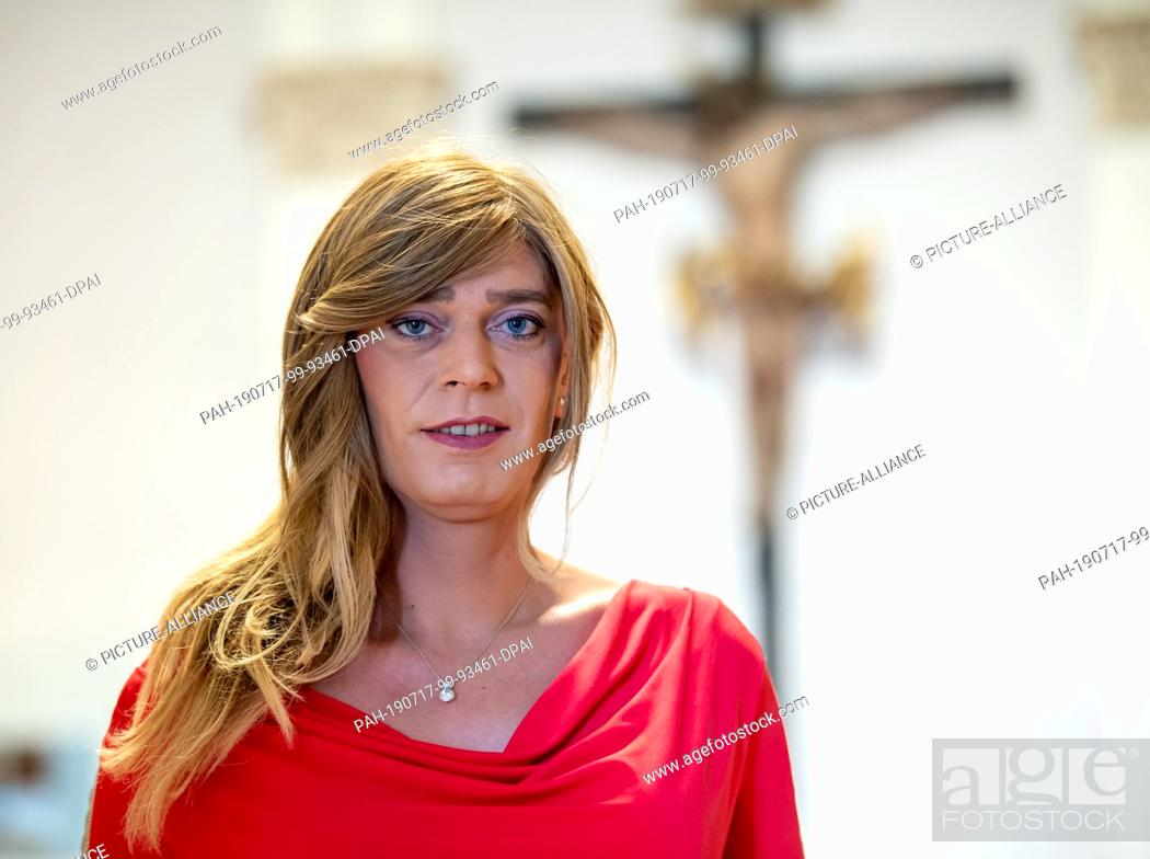 Stock Photo: 17 July 2019, Bavaria, Munich: Tessa Ganserer (Bündnis 90/Die Grünen) is about to start the plenary session in the stairwell of the Bavarian parliament.