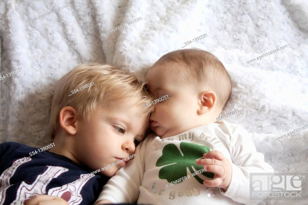 Stock Photo: Two brothers, three years old and four months old.