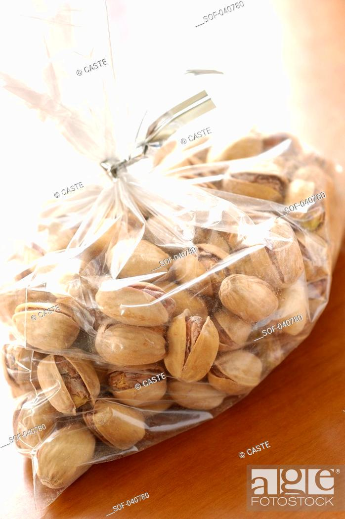 Stock Photo: packet of pistachios.