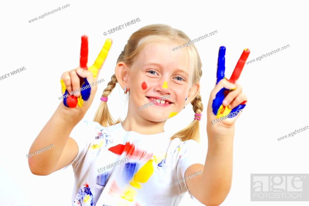 Imagen: little child with hands painted in colorful paints ready for hand prints.