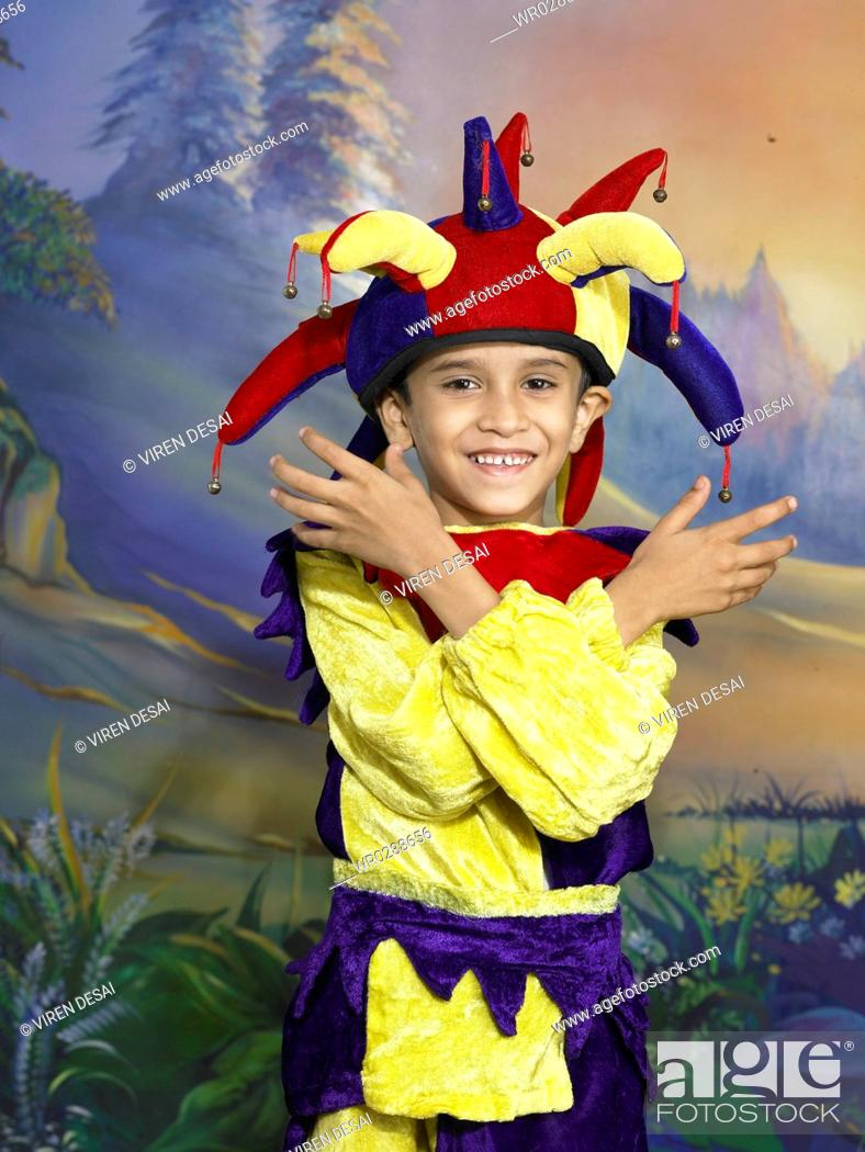 c20caa91a Stock Photo - South Asian Indian boy dressed as joker performing fancy  dress competition on stage in nursery school MR