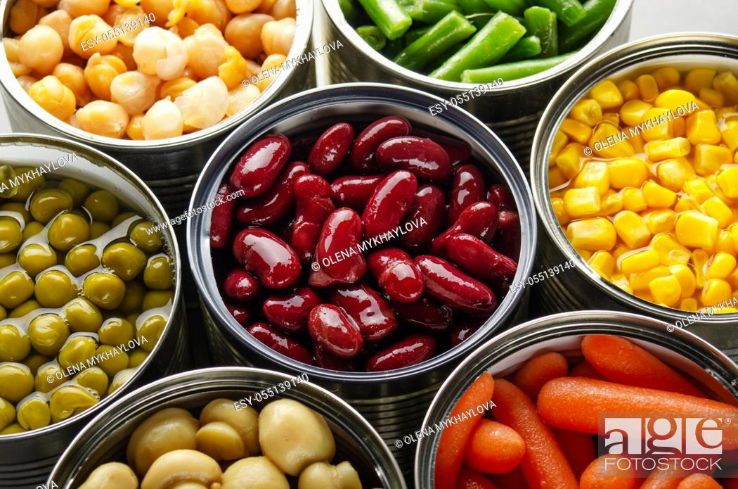 Stock Photo: Canned vegetables in opened tin cans on kitchen table. Non-perishable long shelf life foods background.