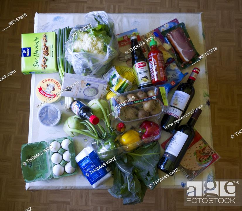 Stock Photo: The result of Grocery shopping on a kitchen table , Germany.