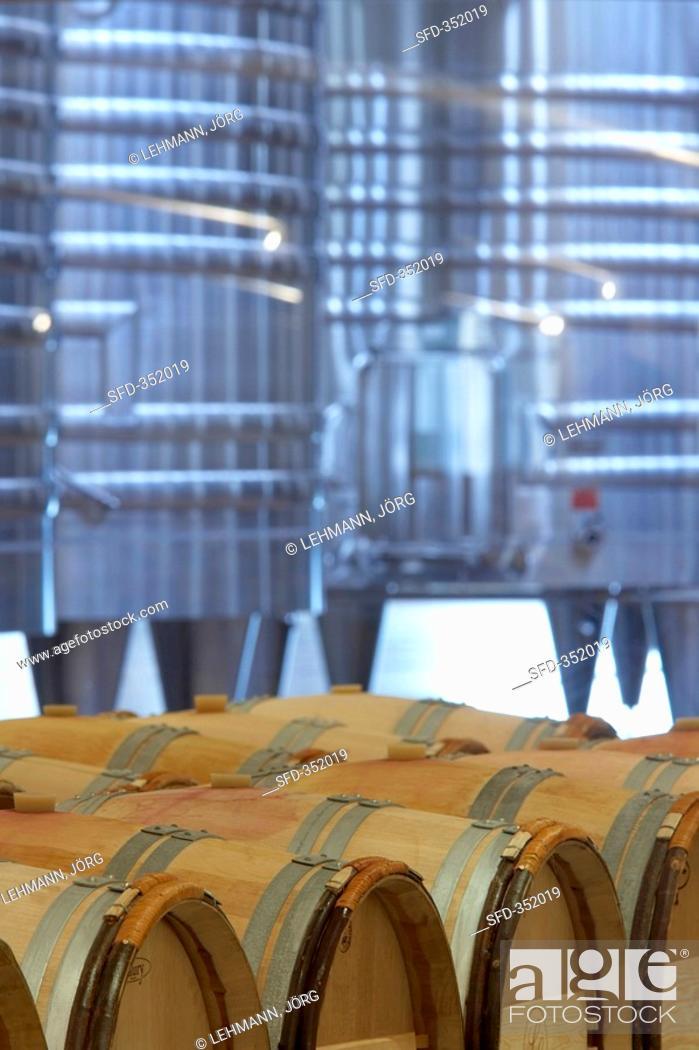 Stock Photo: Stainless steel tanks & wine barrels, Château La Lagune, Bordeaux.
