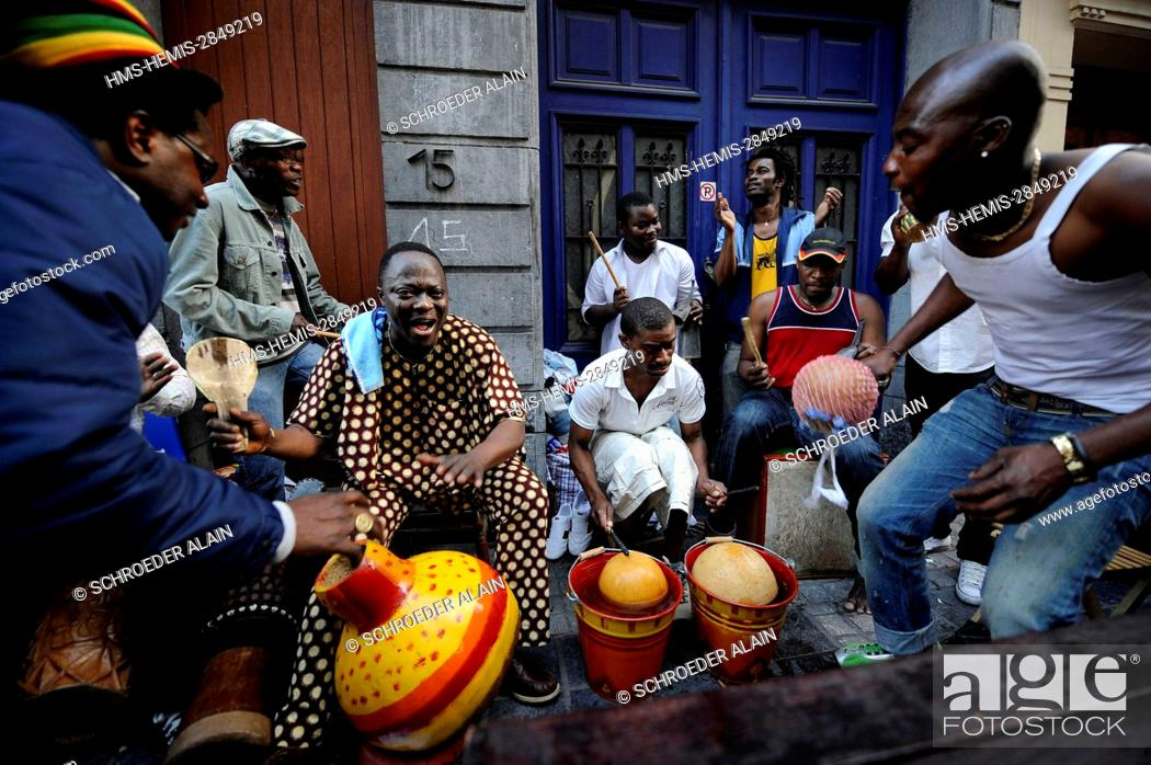 Stock Photo: Belgium, Brussels, Matonge neighbourhood in Ixelles rue de la Longue-Vie, daily life during a local festival, Fidèle Affannou and his band Alafia playing in the.