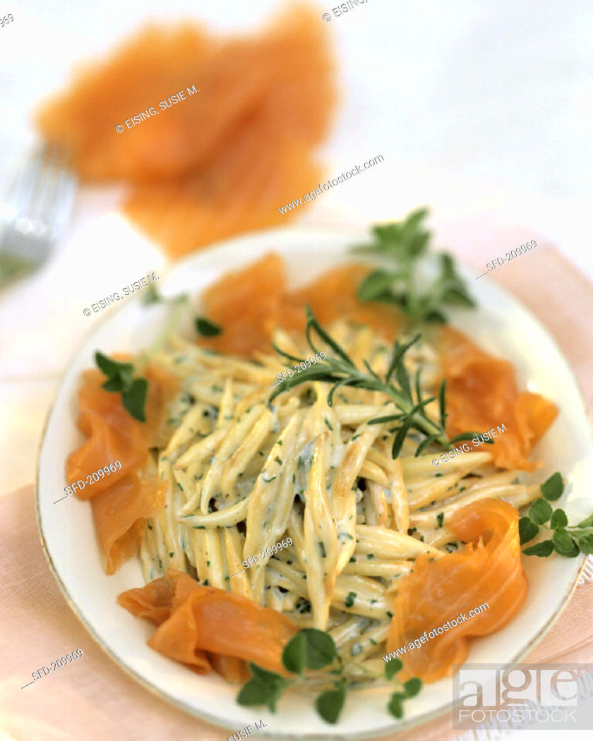 Stock Photo: Noodles with salmon, cream sauce and herbs.