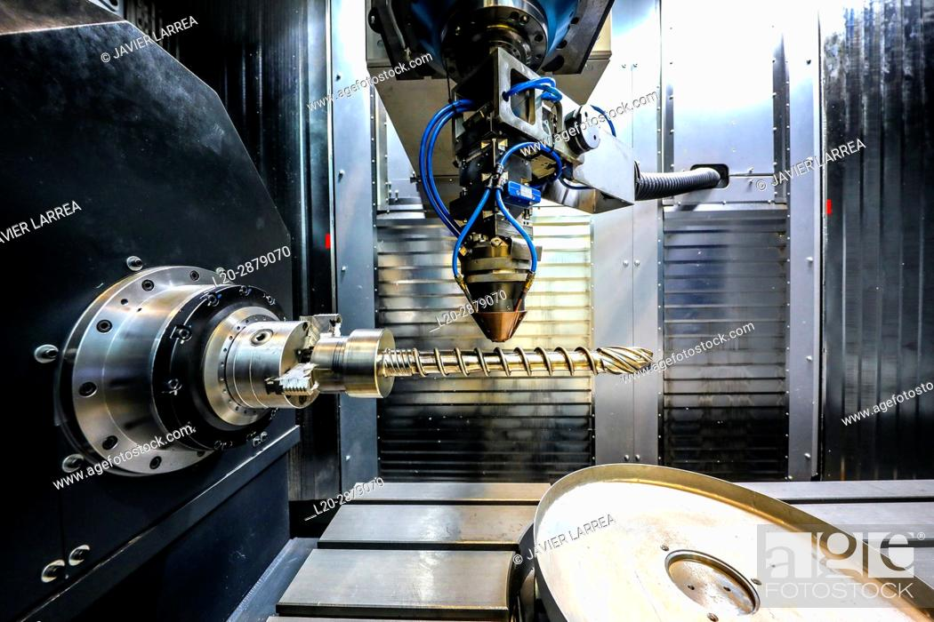 Stock Photo: Researcher working on 3D printing machine for the industry, it allows to create large metal parts from scratch and to finish them to great precision.
