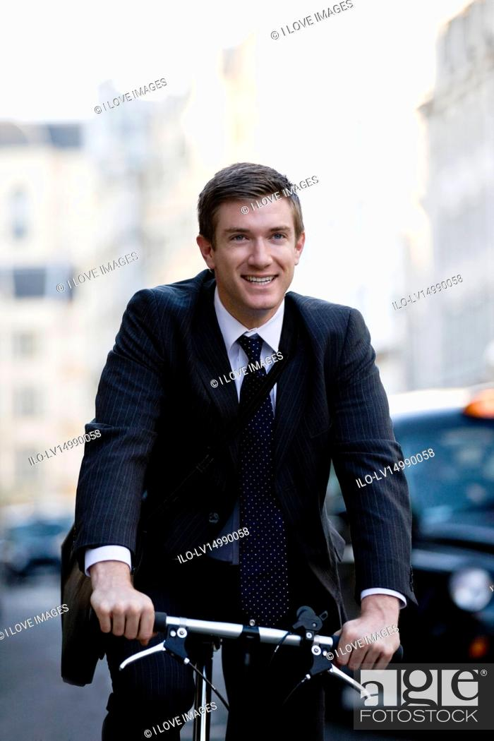 Stock Photo: A businessman commuting to work.