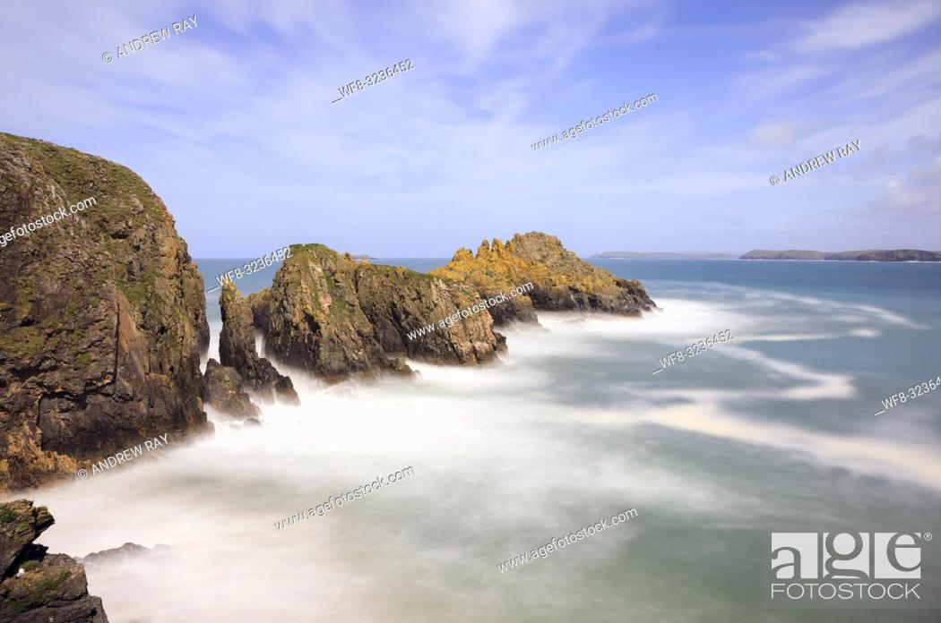 Stock Photo: Merope Rocks in Mother Ivey's Bay on the North Cornish Coast captured from the walkway to Padstow RNLI Lifeboat Station. A long exposure was utilized to blur.