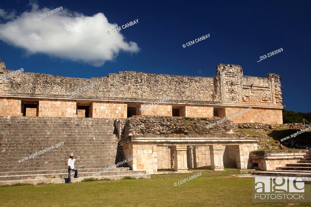 Photo de stock: Tourist walking in Uxmal Ruins near the Quadrangle Of The Nuns, Yucatan Province, Mexico, Central America.