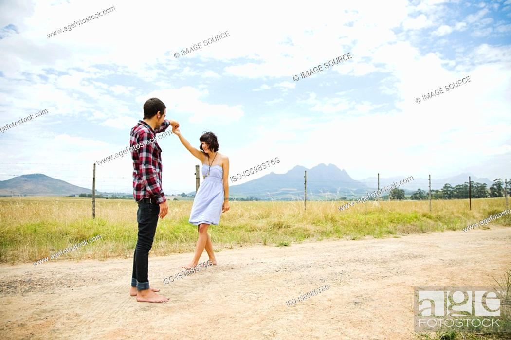 Stock Photo: Young couple dancing in remote setting.