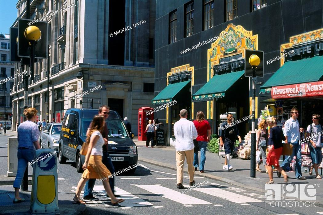 Stock Photo: England - London - zebra crossing - people crossing street at crosswalk.