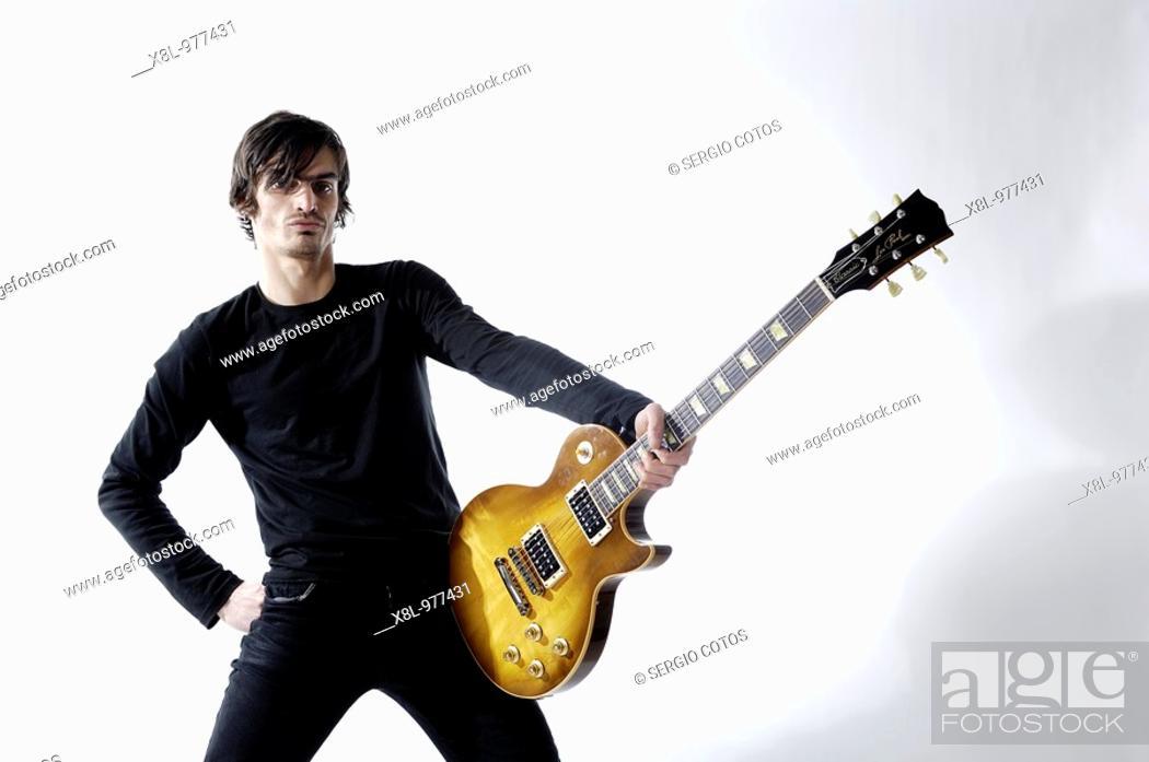 Stock Photo: Guitarist posing.