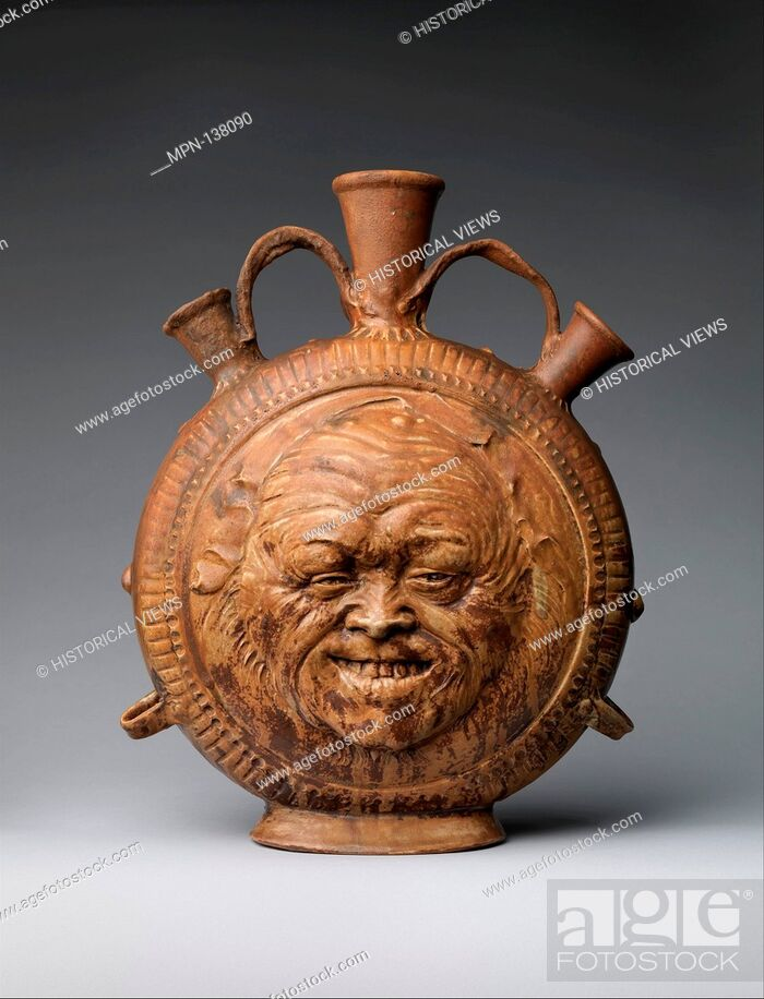Stock Photo: Flask with face. Maker: Jean-Joseph Carriès (French, 1855-1894); Date: ca. 1890; Culture: French, Saint-Amand-en-Puisaye; Medium: Glazed stoneware; Dimensions:.