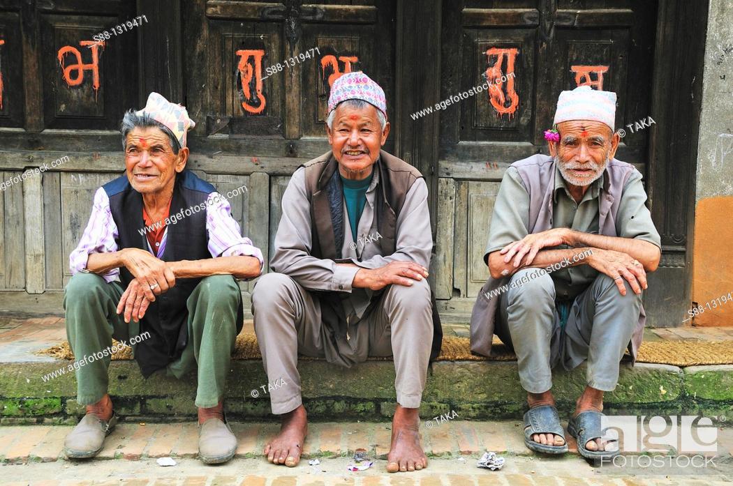 Stock Photo: Old friends sit together, Bhaktapur Bhadgaon Kathmandu valley Nepali.