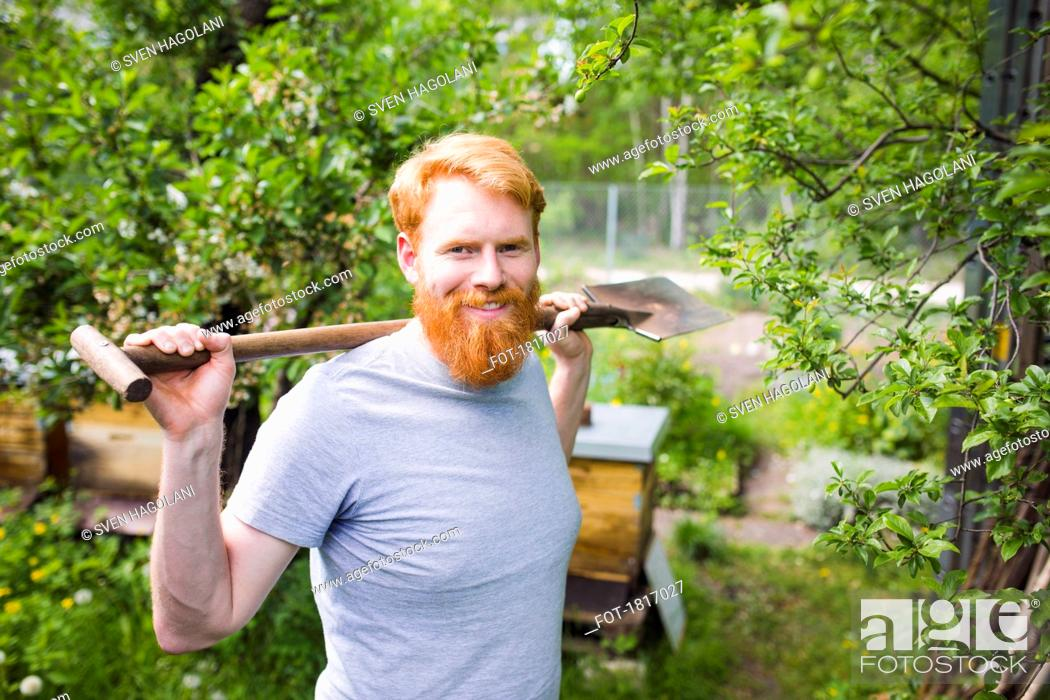 Stock Photo: Portrait confident, smiling man with shovel in garden.