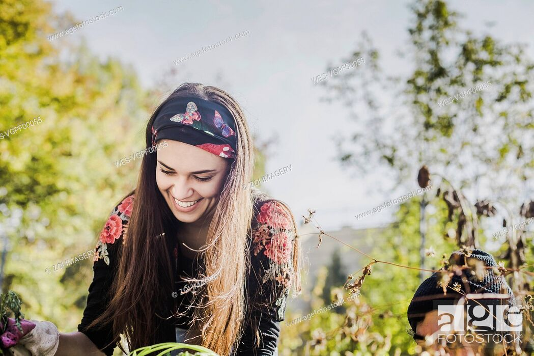 Stock Photo: Happy young woman gardening.