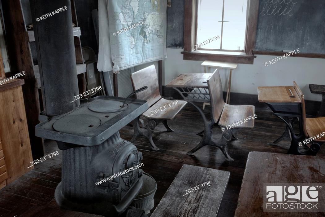 Stock Photo: Interior of an Abandoned Scholl house at sunset in Kansas.