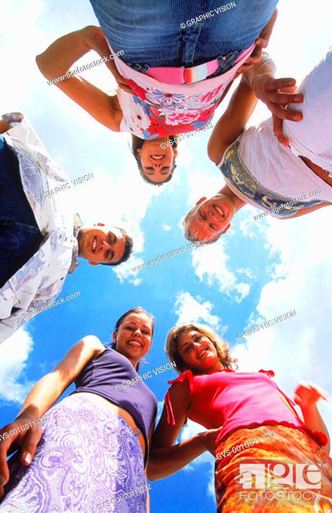 Stock Photo: A group of young people looking down.