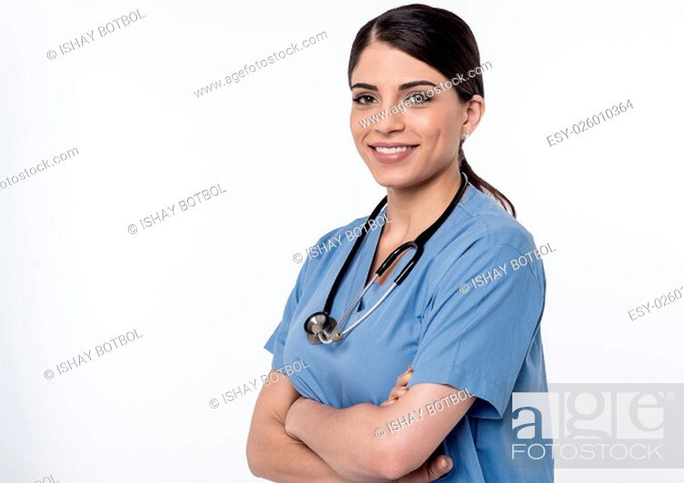 Stock Photo: Smiling female doctor posing with arms crossed.
