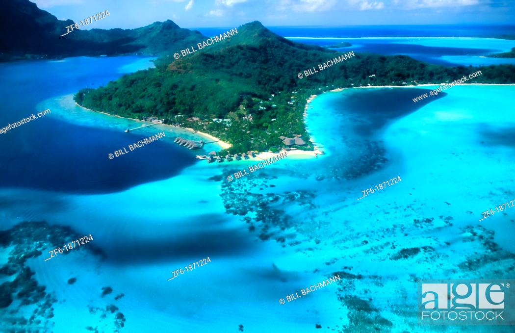 Stock Photo: Aerial of the green water and clear blue colors of the islands of Bora Bora in Tahiti in French Polynesia.