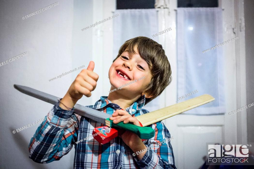 Stock Photo: Portrait of baby with no teeth and some with wooden sword.