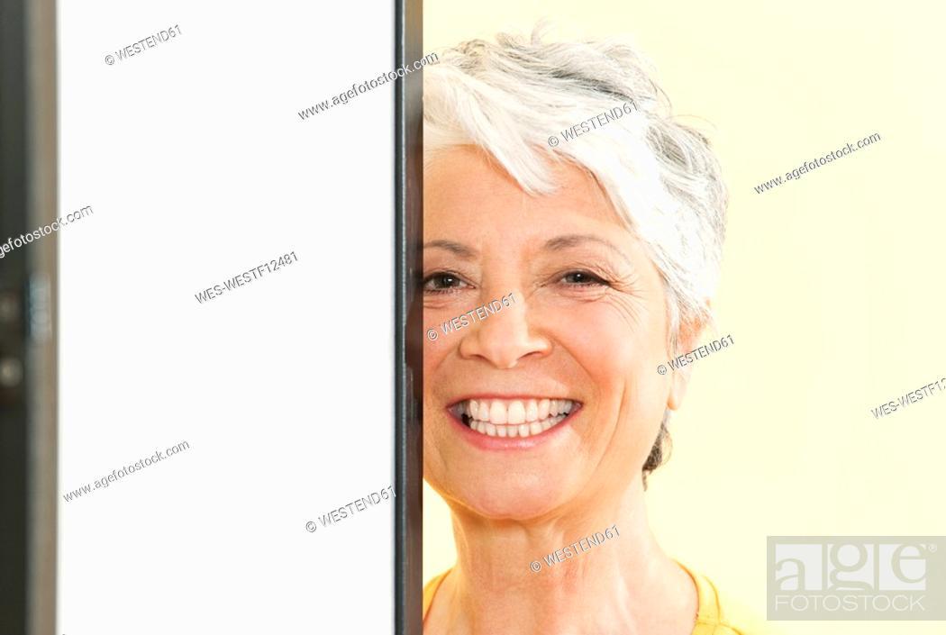 Stock Photo: Senior woman smiling, portrait, close-up.