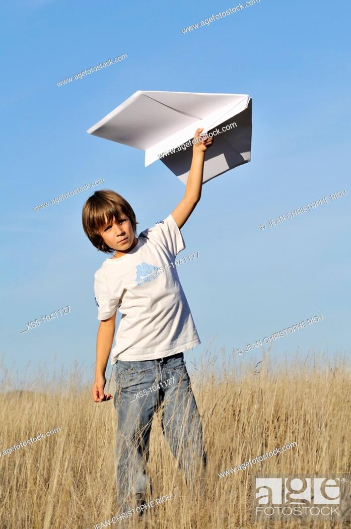 Stock Photo: Boy and paper plane.