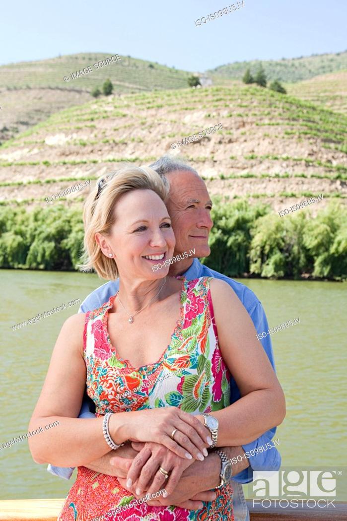 Stock Photo: Senior couple on holiday on boat.