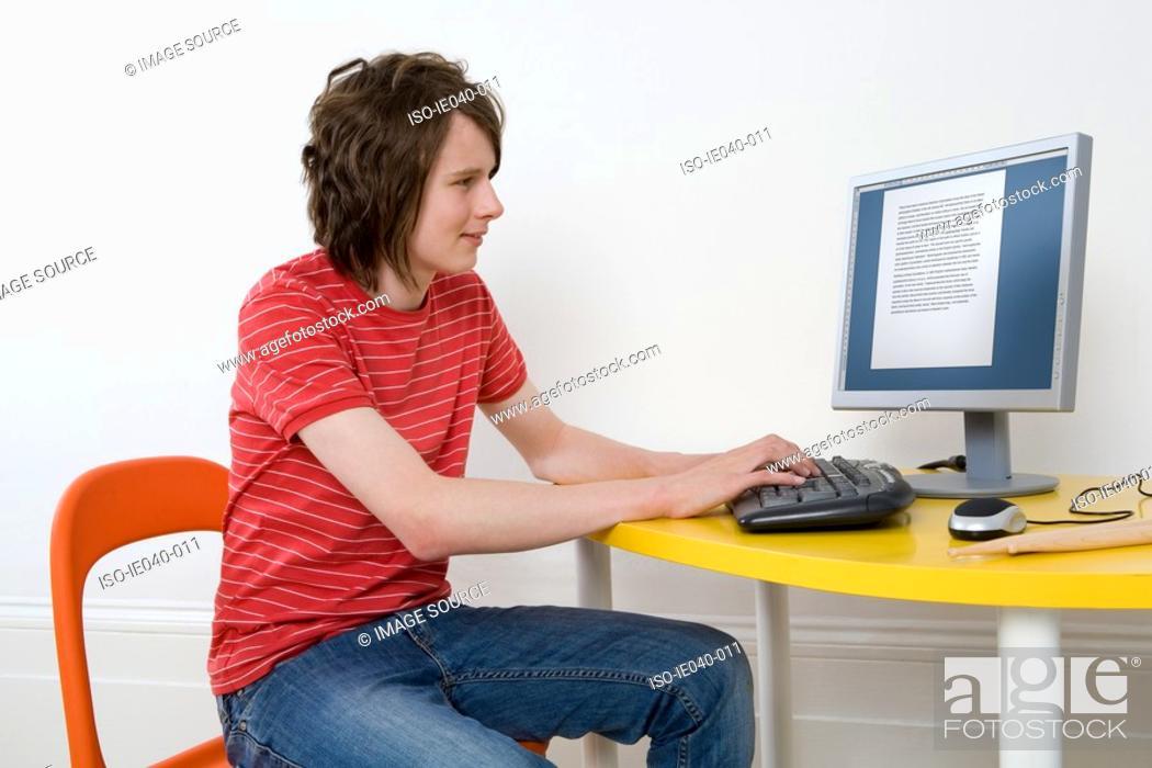 Stock Photo: Teenage boy using personal computer.
