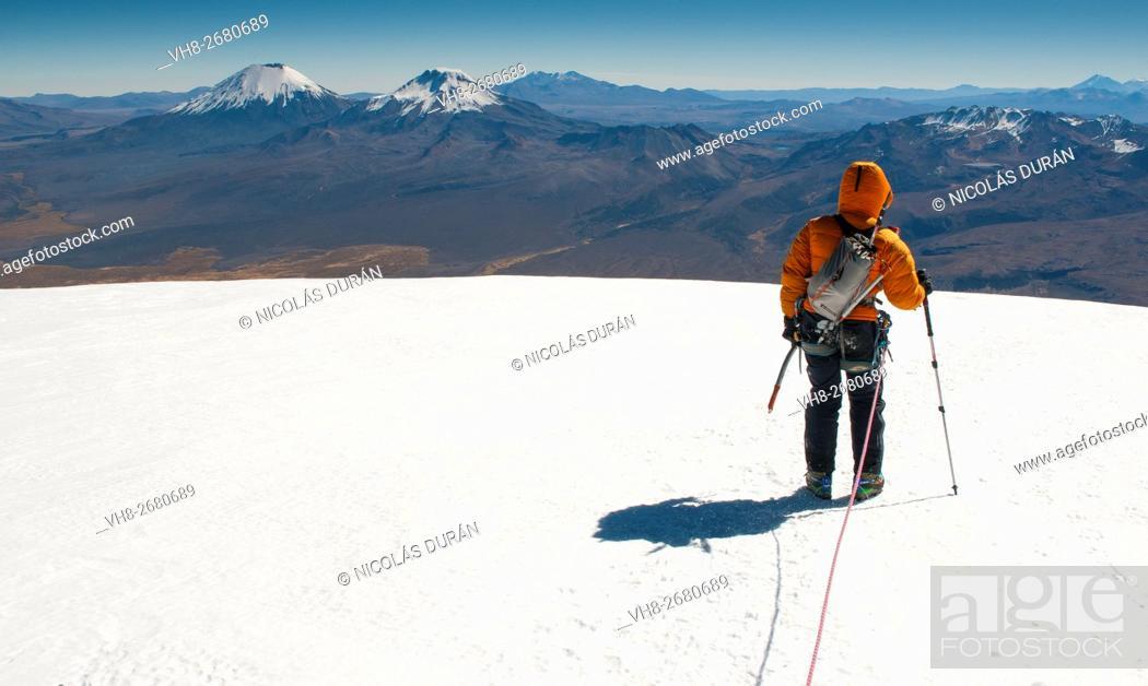 Stock Photo: Climber on the summit of Sajama Volcano. The highest mountain in Bolivia (on the horizon Pomerape and Parinacota volcanoes) Sajama National Park.