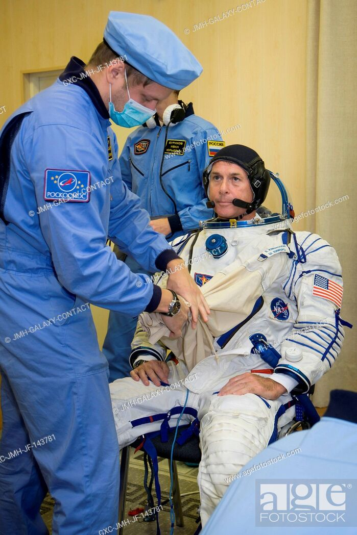 Stock Photo: Expedition 49 flight engineer Shane Kimbrough is helped into his Sokol launch and entry suit in preparation for conducting the first check dress rehearsal.