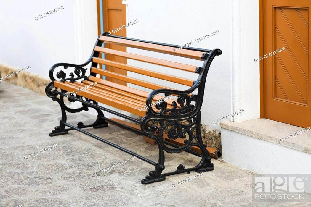 Stock Photo: Bench outside of a building, Patmos, Dodecanese Islands, Greece.
